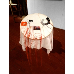 Aglaia Haritz UTOPIA AND REGRESSION ORANGE printed videostill sewn on fabric 50x50x60 cm 2012